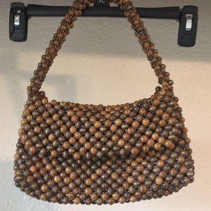 Wooden beaded clutch bag.